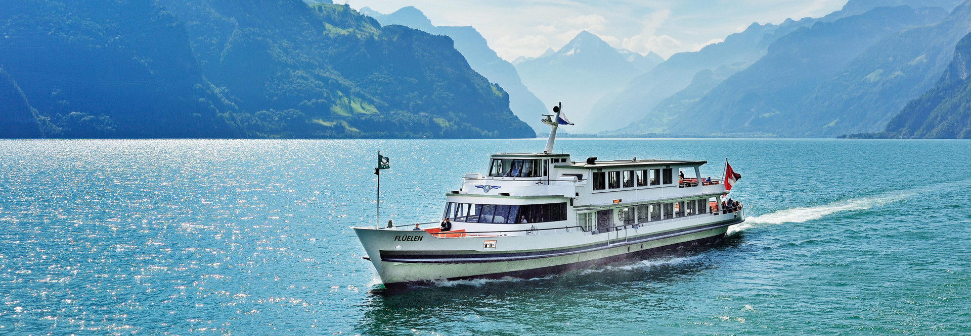 The motor vessel Flüelen sails from Uri to Lucerne on a beautiful summer day.