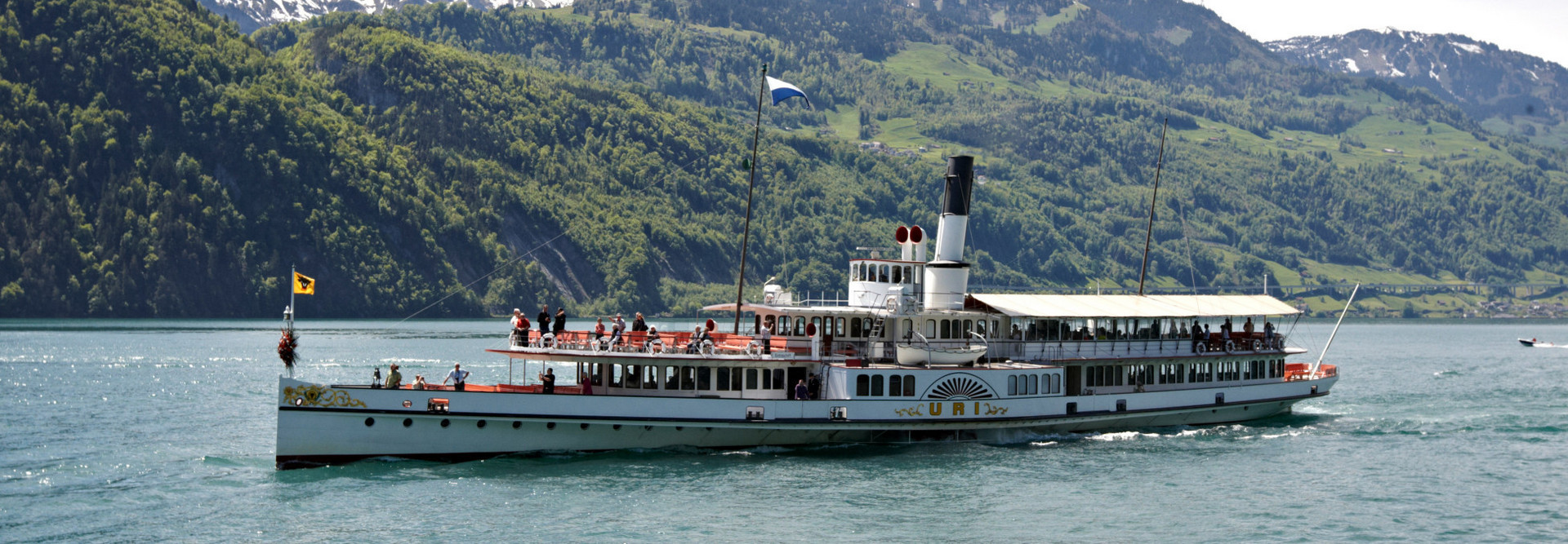 Steamboat Uri in front of the Seelisberg during a trip on Lake Lucerne.