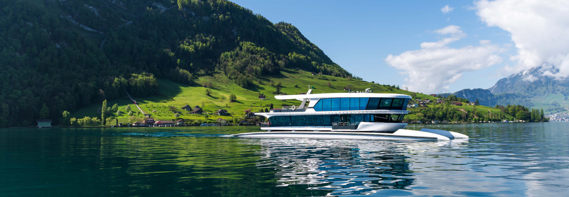 The motor vessel Bürgenstock sails for Lucerne on a beautiful summer day.
