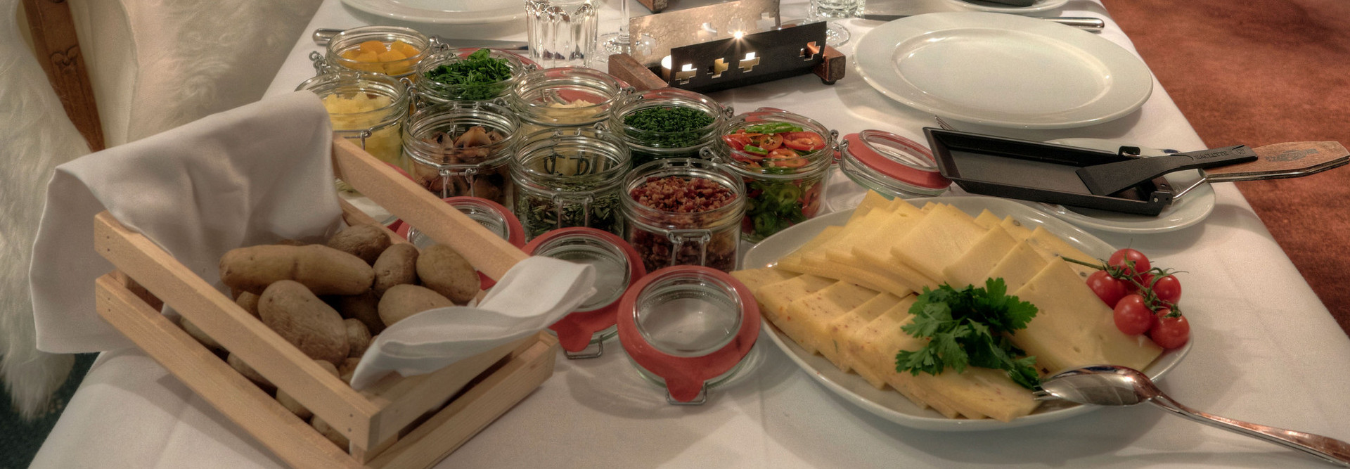 The table is set with many delicious side dishes