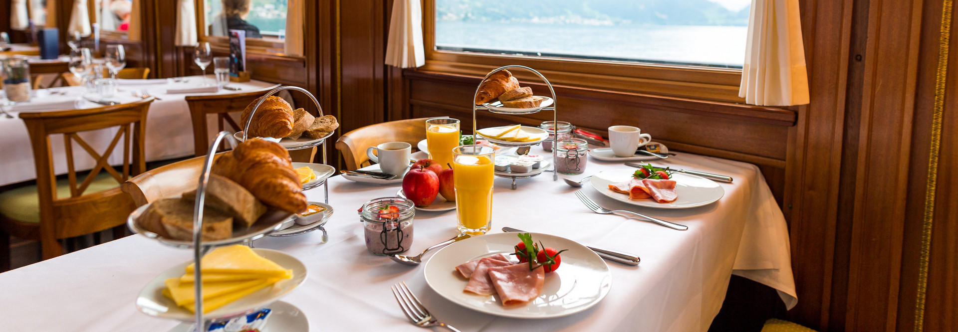 Fresh bread and croissants as well as delicious muesli are served on the breakfast cruise.
