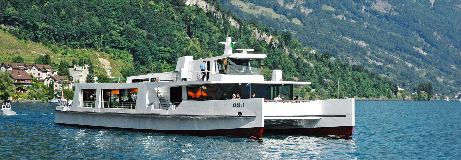 On a beautiful summer's day the motor ship Cirrus sails on Lake Lucerne.
