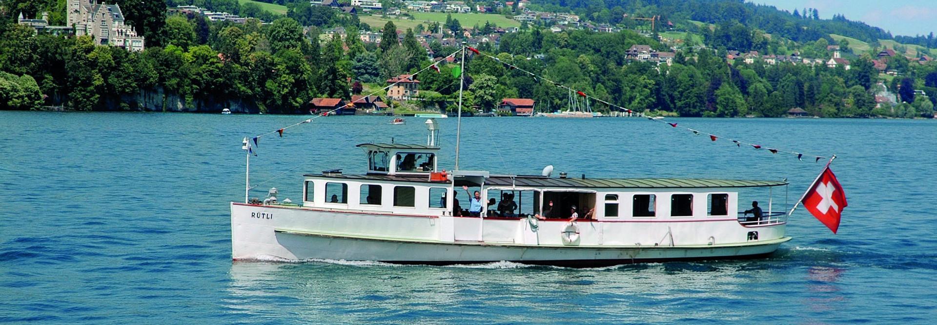 The motor vessel Rütli sails on Lake Lucerne in fine weather.