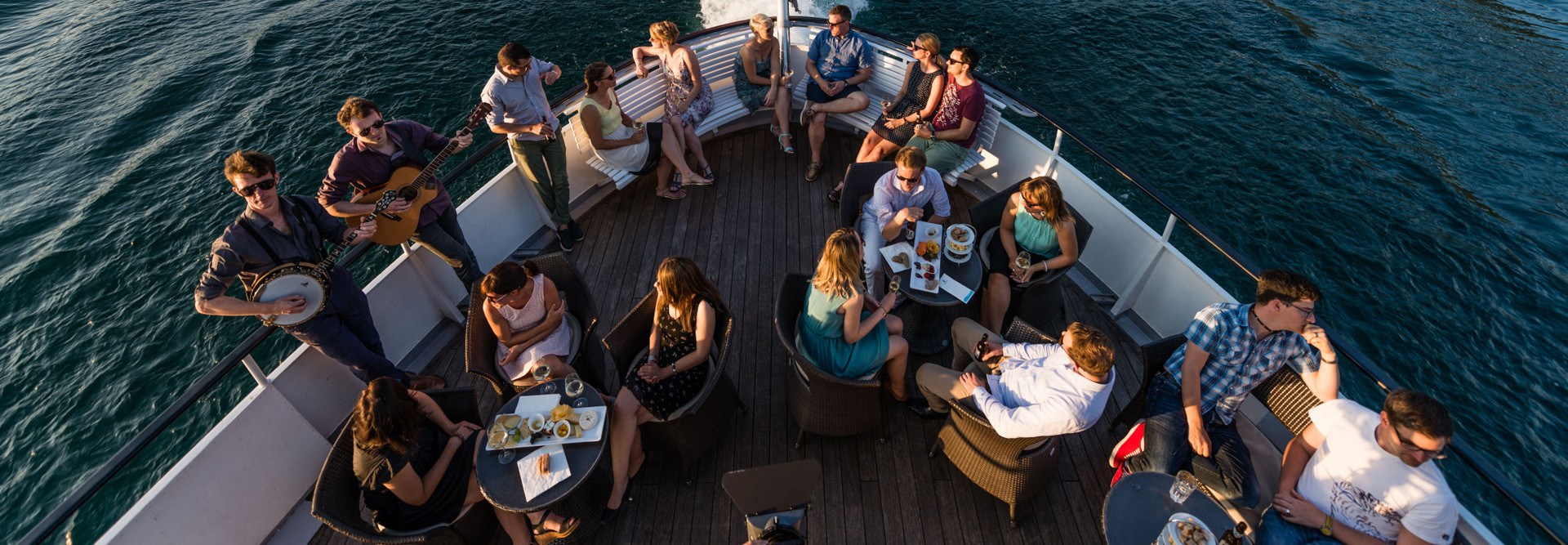 Open-air company aperitif on Lake Lucerne at summer.