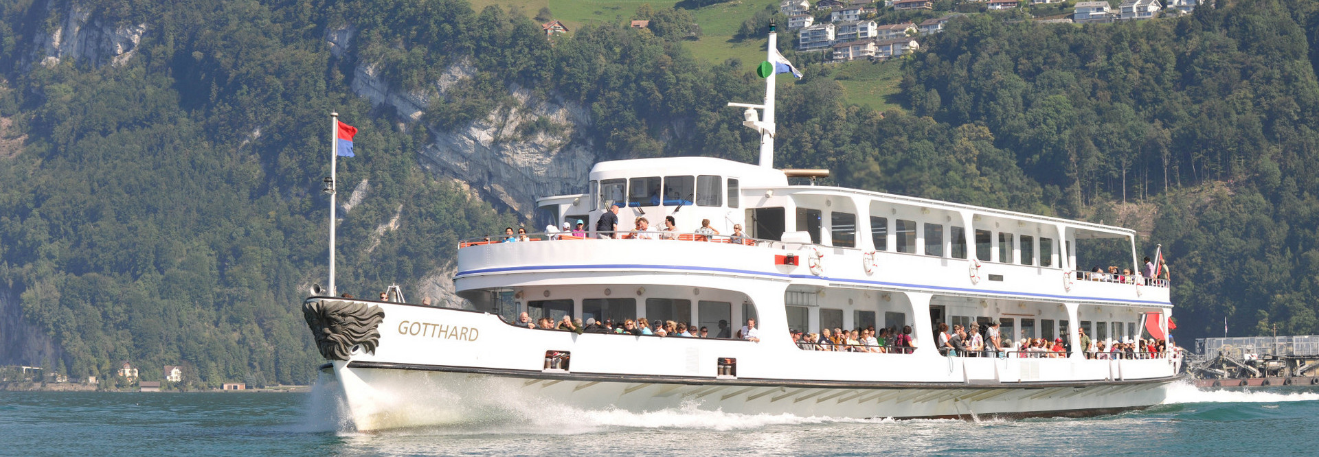 The motor vessel Gotthard sails on Lake Lucerne on a beautiful summer day.